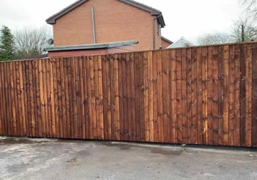 vertical board wooden fencing