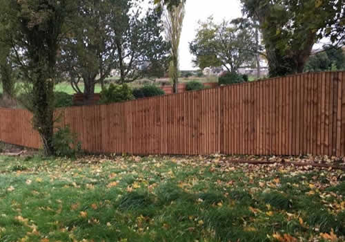 long run of vertical board fencing