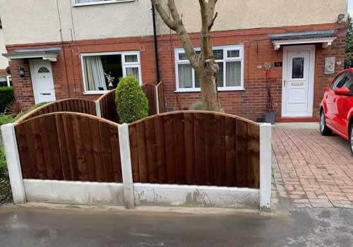small front garden fence with concrete post and curved fence panels